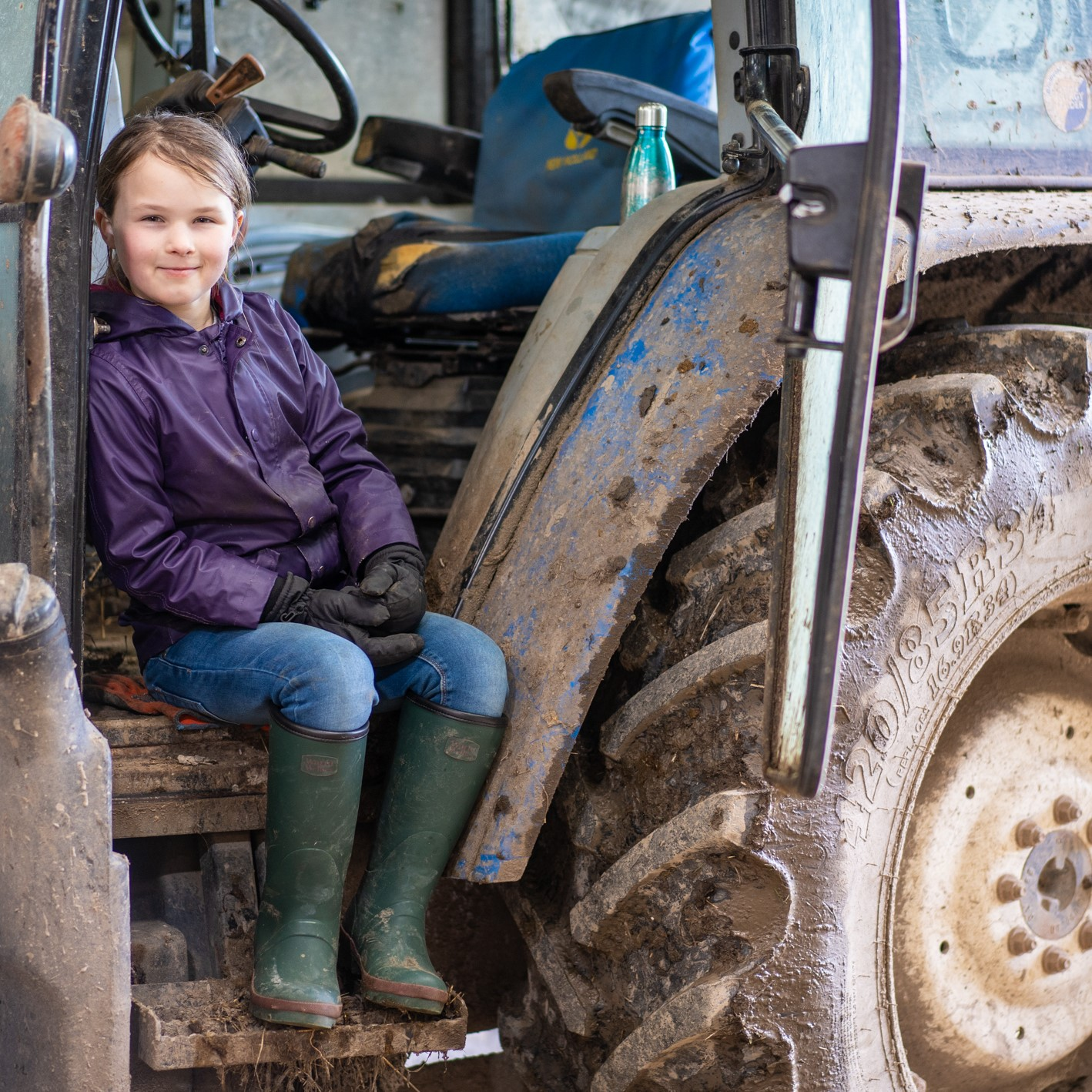 girl on a tractor